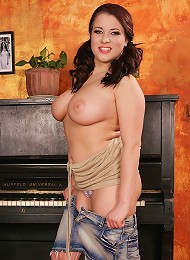 Busty babe Teri strips and shows off her huge jugs