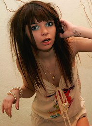 Petite brunette teen Kaira plays in her cute skimpy dress